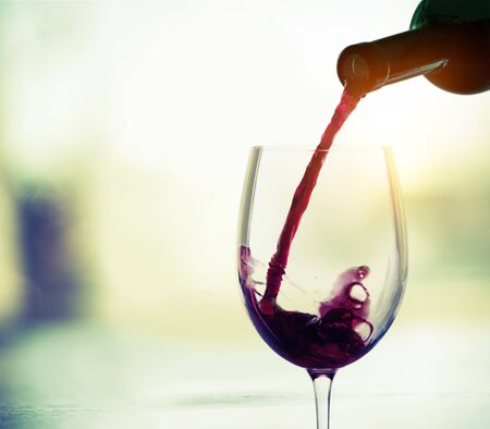 Red wine glass  on  background Banco de Imagens
