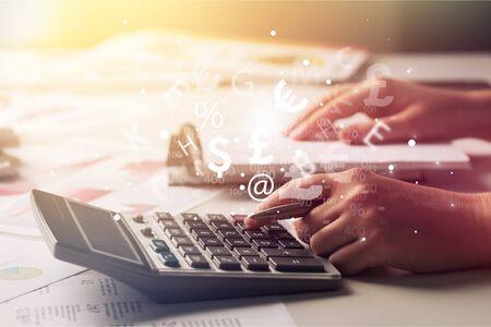 Woman using a calculator Stock Photo