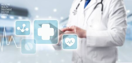 Medicine doctor and stethoscope using tablet with icon medical network connection on virtual screen interface in hospital background. Modern medical technology concept.