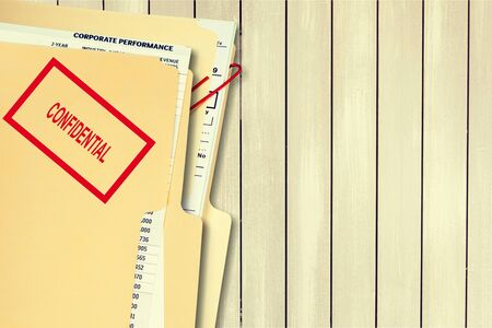 Folder with confidential papers on table