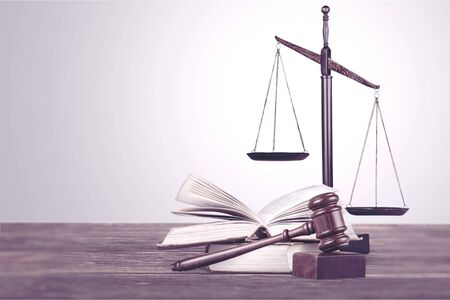 scales of justice on law books in a courtroom or law firm. concept of law,legal education. Reklamní fotografie