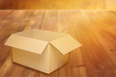 Cardboard box on desk 免版税图像