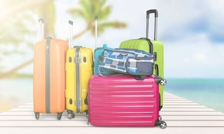 Retro suitcase with travel objects  on sea background 版權商用圖片