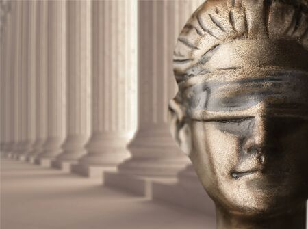 Face of Lady Justice in black background and space for text