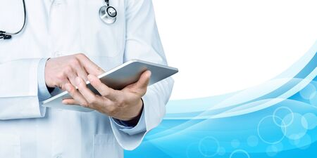 Doctor at hospital working with tablet pc