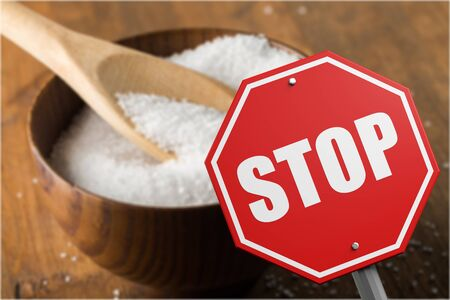 Stop sign on the sugar, warned that the sugar too much will make unhealthy nutrition, obesity, diabetes, dental care and much more. Banco de Imagens