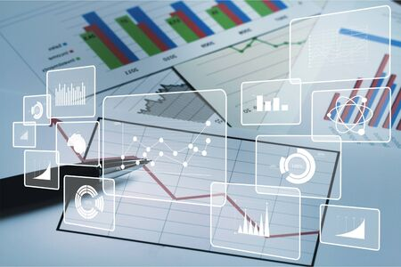 Big data analytics and business intelligence concept with chart and graph icons on a digital screen interface and a businessman in background Stockfoto