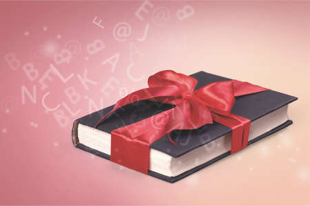 Present box on white tied with red type