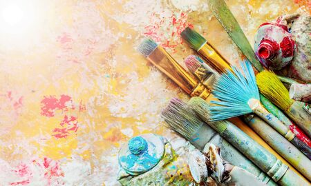 Row of artist paint brushes  on background 免版税图像