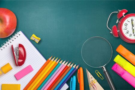 School supplies on black board background. Back to school concept Zdjęcie Seryjne - 128880460