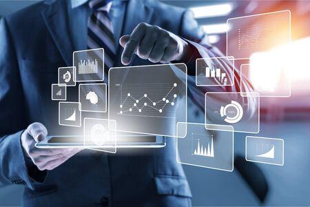 Intelligence (BI) and business analytics (BA) with key performance indicators (KPI) dashboard concept.Website designer working digital tablet and smart phone.