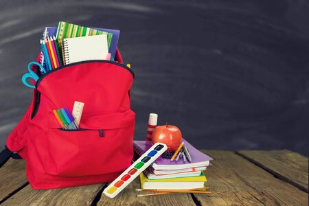 Red School Backpack with colorful stationary 写真素材