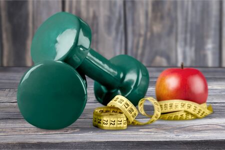 Isolated image of dumbbells and measurement