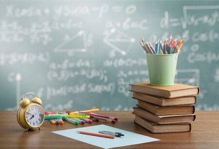 Stack book on chalkboard background