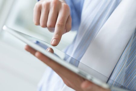 Person holding a tablet computer