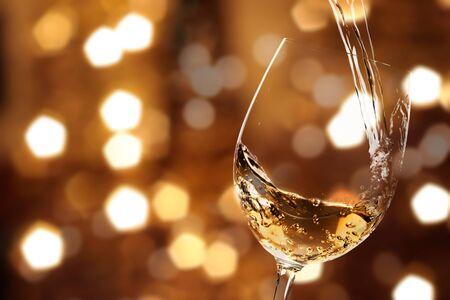 White wine splash isolated on background 写真素材