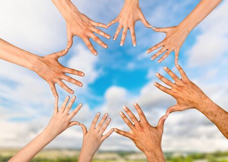 Group of people stacking hands together Stock Photo - 128901401