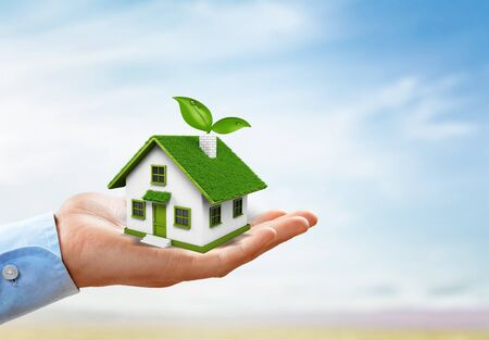 hands holding house. Real estate and property concept. Zdjęcie Seryjne