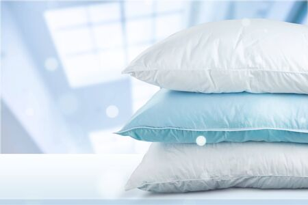 Soft Pillows Pile on grey background, three pillows, sleeping items. Banco de Imagens