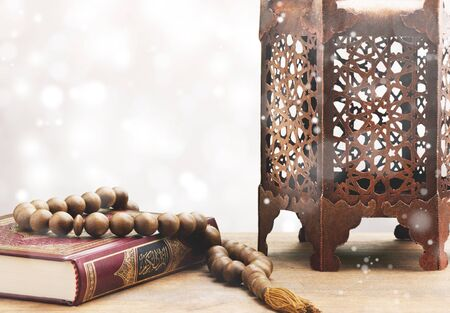 Three months.Islamic Holy Book Quran with rosary beads under soft light on White Background. Ramadan concept .