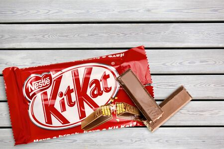 Kit Kat is a chocolate covered wafer bar isolated on white background Editorial