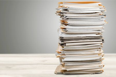 Stack of papers isolated on white background Reklamní fotografie - 128902921