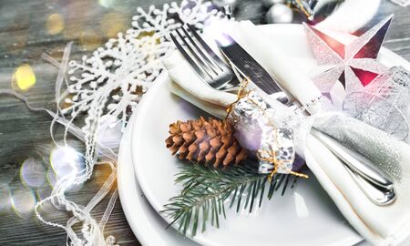 Festive table setting with cone for Christmas celebration