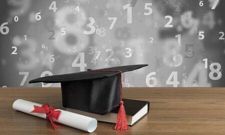 Graduation black hat on desk Stok Fotoğraf