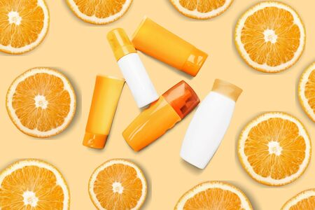 Natural vitamin c skincare products w fresh juicy orange fruit slice on orange background. Cosmetic beauty product branding mock-up for moisturizing cream, lotion, serum or essential oil. Top view.          - Image Stok Fotoğraf