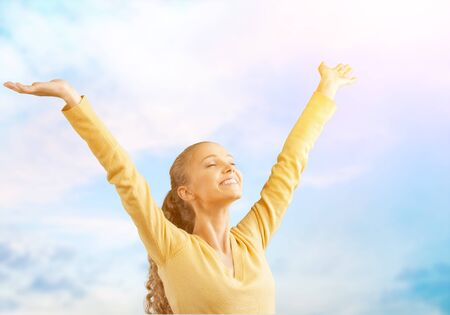 Young happy Woman with arms outstretched Фото со стока - 128905082