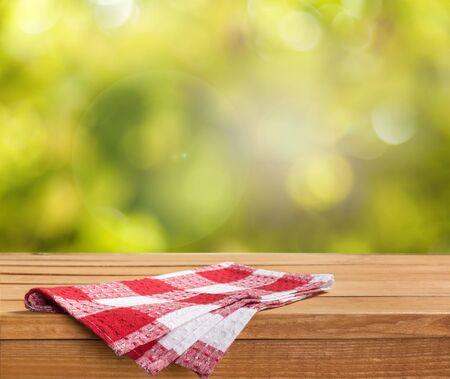 Empty tray on tablecloth on wooden table Stok Fotoğraf