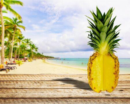 Whole fresh pineapple on desk 스톡 콘텐츠