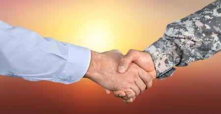 Business Agreement Handshake on  background