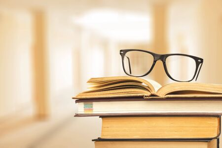 Books and glasses on  table  background,close up