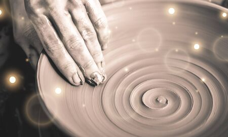 Hand of potter doing clay pot on