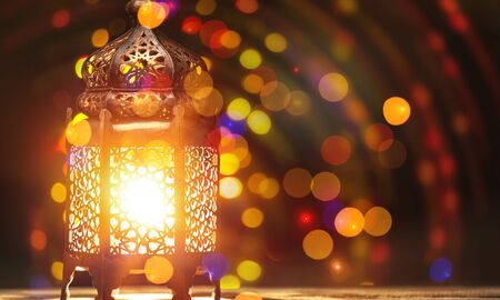 Arabic lantern with candle at night for Islamic holiday. Muslim holy month Ramadan. The end of Eid and Happy New Year. Copy space on dark background. Stok Fotoğraf