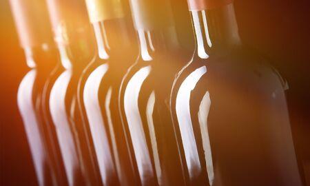 Closeup of dark wine bottles in row