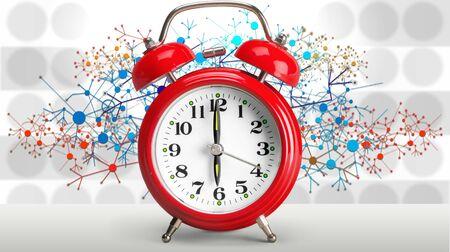Retro alarm clock on blurred background