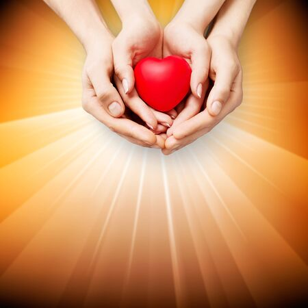 Human hands with red heart