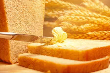 Slices of bread with butter on wheat
