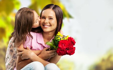 Happy Mother and daughter hugging  with flowers
