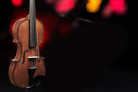 Wooden classic violin on dark background