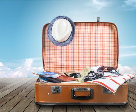 Suitcase with clothes and other travel accessories