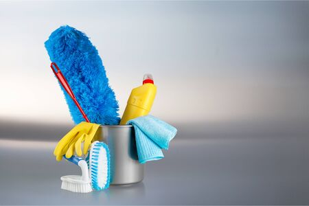 Cleaning supplies and gloves in plastic bucket Stock Photo