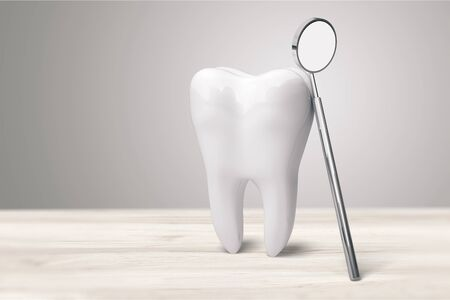 Big tooth and dentist mirror in dentist