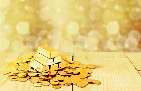 Lingotes de oro y monedas en backgrouund.