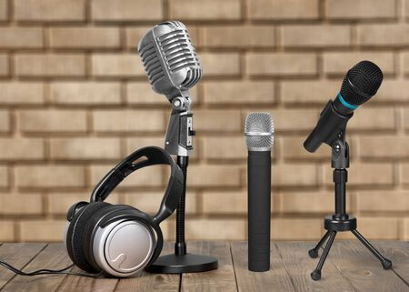 Retro old group microphones on wooden desk