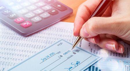 Business man prepare writing a check on background Reklamní fotografie
