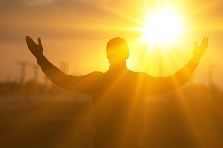 Silhouette man happy with hands rise up on beautiful. Christian praise on hill thanksgiving day background. Man consumed by wanderlust nature standing open arms enjoying sun concept fun wisdom modern