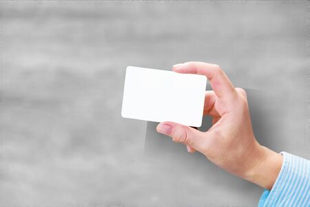 Hand hold blank translucent card mockup with rounded corners. Plain clear call-card mock up template holding arm. Plastic transparent acrylic namecard display front. Stockfoto